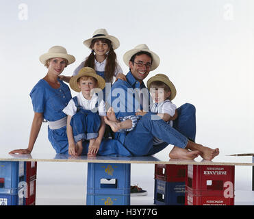 Family, hats, happy, hand, head, rest on, there, smile, group picture parents, woman, man, children, boys, girls, - Stock Photo