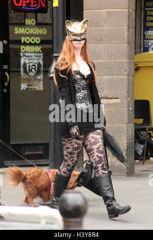 Young girl Goth strolling in Whitby during the annual Spring Goth Festival - Stock Photo