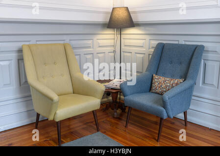 Two Armchairs And A Floor Lamp On A Reading Corner   Stock Photo