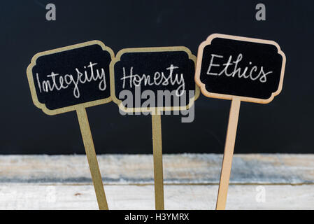 Business message Integrity, Honesty, Ethics written with chalk on wooden mini blackboard labels - Stock Photo