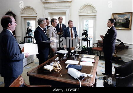 Photograph of President Ronald Reagan learning about the assassination of President Anwar Sadat of Egypt. Dated - Stock Photo