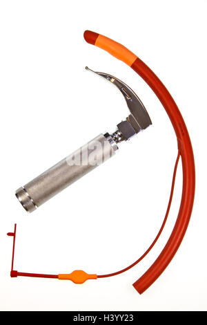 A cuffed endotracheal tube which is passed through the larynx into the windpipe, using the laryngoscope shown - Stock Photo