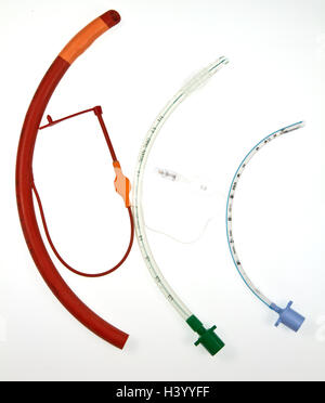 Three endotracheal tubes which are passed through the larynx into the windpipe, using a laryngoscope , during an - Stock Photo