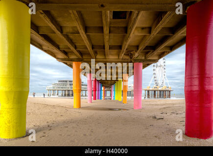 Low angle view on Scheveningen Pier with its colorful pillars, on the Dutch coast of The Hague, South Holland, The - Stock Photo