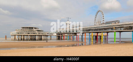 Wide angle view on Scheveningen Pier, a bungy-jumping tower and a ferris wheel, The Hague, South Holland, The Netherlands. - Stock Photo