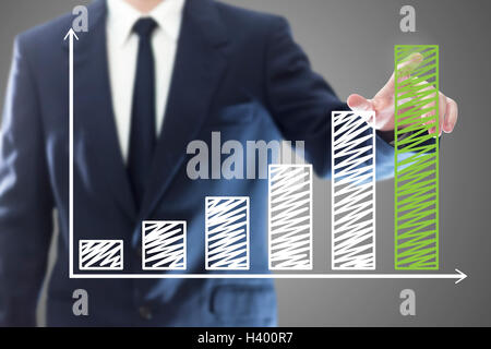 Businessman presenting a successful sustainable development on a bar chart - Stock Photo