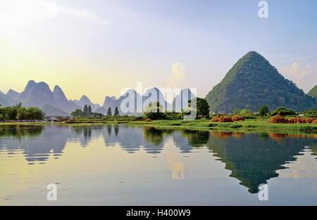 Mountain reflections in Li River, Yangshuo near Guilin, China - Stock Photo
