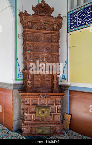 Old porcelain stove. - Stock Photo