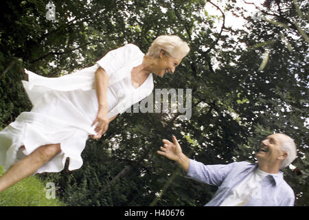Meadow, Senior couple, play laugh, to trap couple, senior citizens, Best Agers, falls in love, gambles away love, - Stock Photo