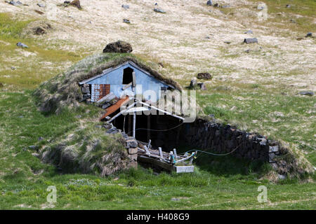 abandoned covered icelandic turf house now used as a field store iceland - Stock Photo