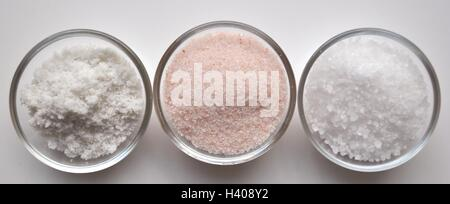 Himalayan and Sea Salt in glass bowls top view close up - Stock Photo