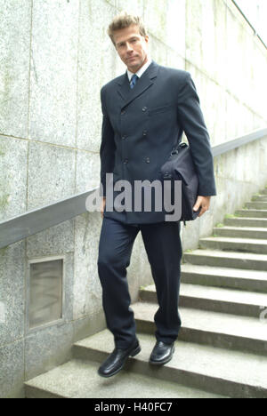 Pedestrian subway, businessman, briefcase, stairs, go, down, town, underpass, steps, man, manager, 30-40 years, - Stock Photo