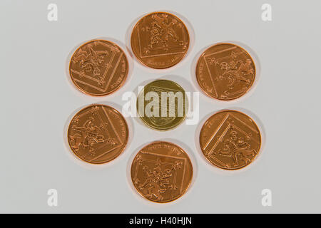 Close-up detail of money - current UK sterling coins in 2 denominations, copper and silver with 2p pieces around - Stock Photo