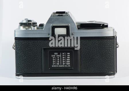 Classic 1980's Minolta X-300 - 35mm film, single lens reflex camera with a 50mm Minolta prime lens, against a white - Stock Photo