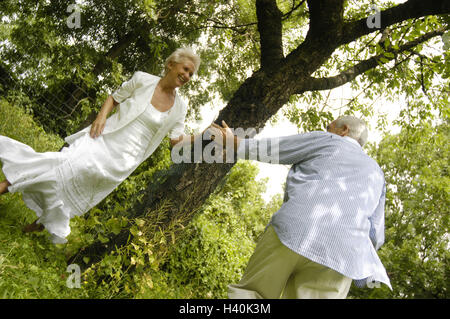 Senior couple, nature, tree, happy, melted, play to trap, leisure time, fun, amusement, joy life, happy, falls in - Stock Photo