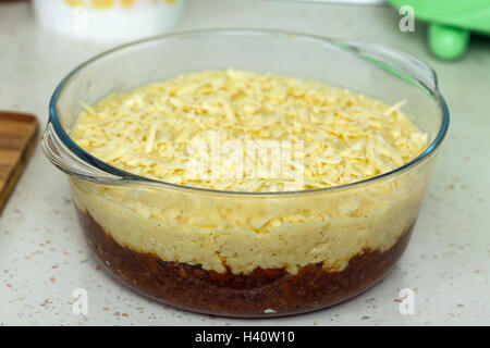Cottage pie in a casserole, before putting it in the oven - Stock Photo