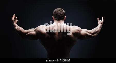 Close up of sports man's muscular back isolated on black background with clipping path - Stock Photo