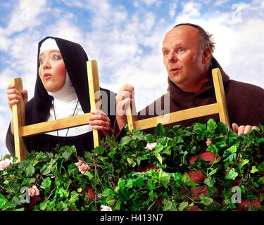 Hedge, monk, nun, conductor, stand, observe facial play, curiosity, astonishment, Composing, professions, studio, - Stock Photo