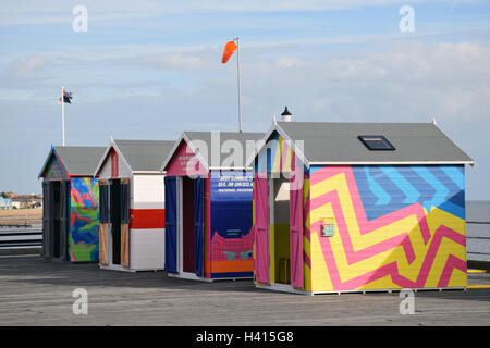 Brightly coloured beach huts on Southend pier as part of the Estuary Festival, Essex Sep 2016 - Stock Photo