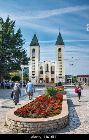 Flower bed at Saint James Church, Catholic pilgrimage site, in Medjugorje aka Medugorje, Bosnia and Herzegovina - Stock Photo