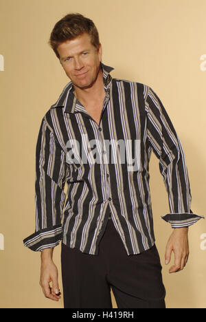 Man, smile young, shirt touched, detail, 30-40 years, stand, blond, laxly, casually, careless, friendly, balance, - Stock Photo