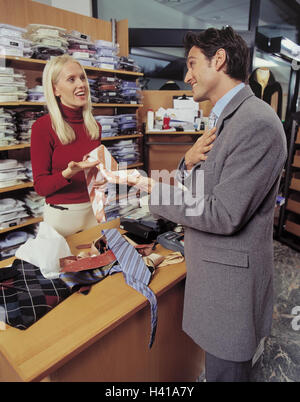 Business, counter, shop assistant, customer, ties, select, gesture, inside, loading, boutique, man, woman, young, - Stock Photo