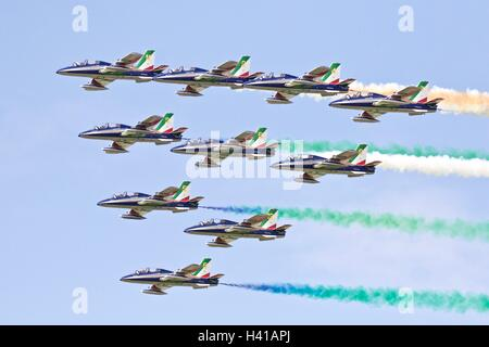 The Italian aerobatic team Frecce Tricolori, 10 Aermacchi AT-339As flying at the Royal International Air Tattoo. - Stock Photo