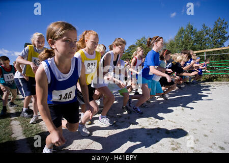 runners at starting line at track meet - Stock Photo