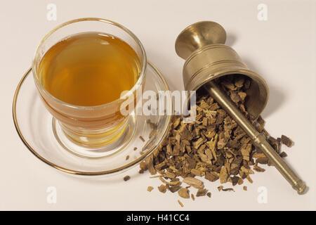 Tea glass, mortar, roots, sweet wooden root tea, Glycyrrhiza glabra, Still life, cut out, glass, teacup, cup, tea, - Stock Photo