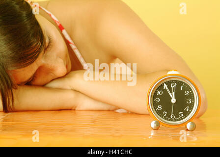 Table, woman, sleep, alarm clock, time, 'shortly in front of twelve', curled, young, 20-30 years, 24 years, sleepy, - Stock Photo