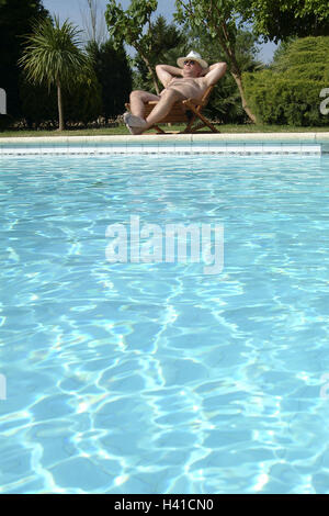 Pool margin deck chair man care take it easy rest back view stock photo 122980171 alamy for How to take care of your swimming pool