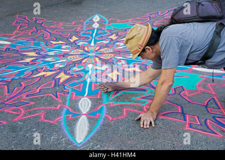 October 2016, Joe Mangrum painting with sand in Union Square Park in Manhattan, New York City/ - Stock Photo