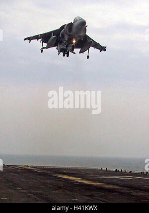 28th January 2003 Operation Enduring Freedom: a U.S. Marines Harrier jump jet hovers above the USS Nassau, in the - Stock Photo