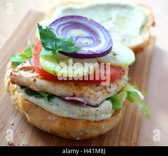 Delicious burger with chicken and vegetables. - Stock Photo
