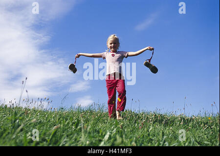 Girls, runs, barefoot, shoes, carries, meadow, summers  Leisure time, vacation, summer vacation, child, 7 years, - Stock Photo