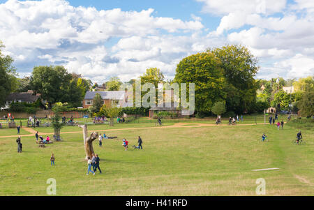People, families and kids enjoying the sunny day in Richmond park near Petersham gate. - Stock Photo