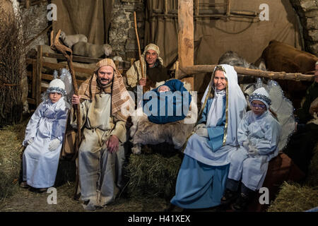 Canale, Italy - December 26, 2015: As every year the medieval town becomes a living Nativity scene. - Stock Photo