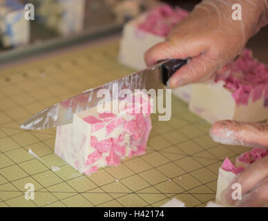 Cutting The Homemade Soap Into Bars - Stock Photo