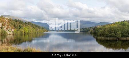 Llyn Padarn lake near the village of Llanberis and the distant Snowdon Massif, Snowdonia National Park, Gwynedd, - Stock Photo