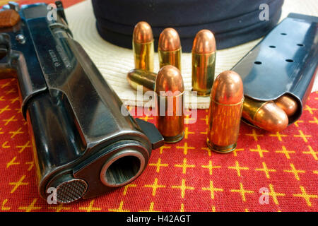 A Colt .45 ACP auto automatic pistol model 1911 and bullets - Stock Photo