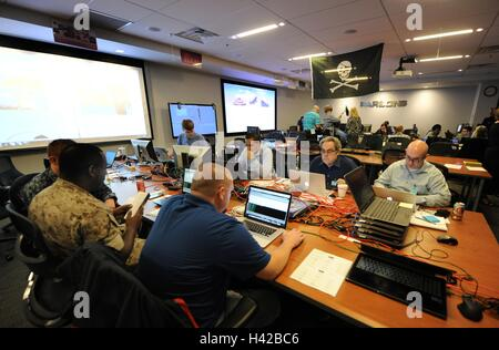 National Security Agency employees work on the Cyber Defense Exercise Red Cell computer security operations competition - Stock Photo