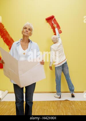 Senior couple flat renovation wall paint yellow red colour flat renovation works woman plan man wall paint red colour solutioingenieria Gallery