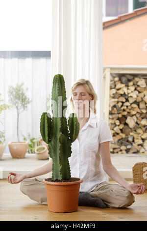Woman, young, indoor plants, cactus, touch, plant book, read up ...