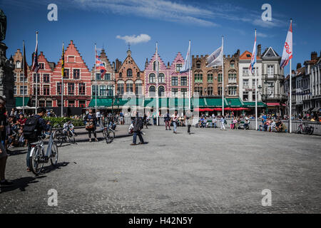 tourists in grote markt market square of bruge stock photo