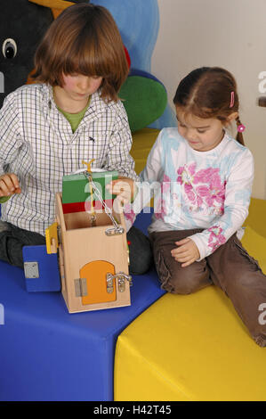 Children, two, play, learning game, kindergarten, person, girl, boy, wooden house, wooden toys, learning toys, toys, - Stock Photo