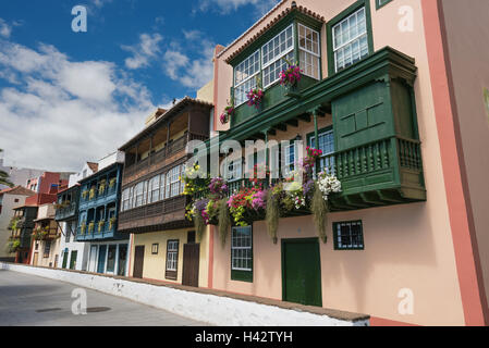 Famous ancient colorful colonies balconies decorated with flowers. Colonial houses facades in Santa Cruz, La Palma, - Stock Photo