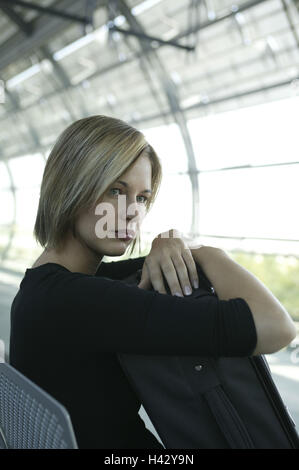 Airport, hall, woman, sit, wait, go away alone, boredom, airport terminal, waiting room, travellers, 20-30 years, - Stock Photo