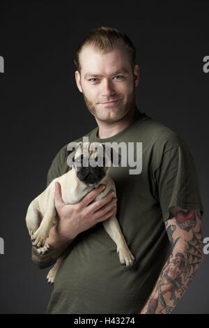 Man, dog, pug, wear, studio, half portrait, - Stock Photo