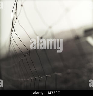 Mesh wire fence, detail, fence, wire netting, wire, wire fence, demarcation, separation, houseing, containment, - Stock Photo