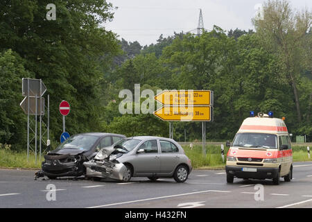 Traffic accident, compact car, broken, rescue cars, detail, street, junction, signs, accident, frontal damage, collision, - Stock Photo